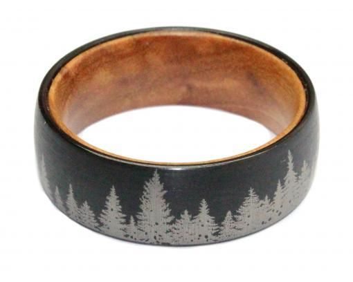 brushed black tungsten engraved with trees and olivewood liner